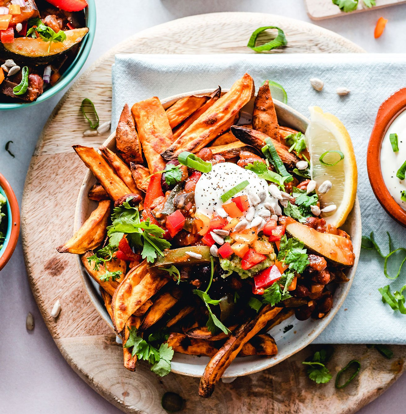 Spicy fries with vegetables salsa and melted cheese